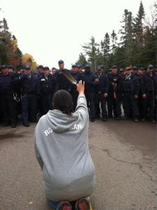 police line RCMP advances tear gassing the crowd