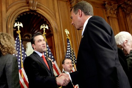 House Speaker John Boehner of Ohio, right, participates in a ceremonial House swearing-in ceremony for Rep. Michael Grimm, R-N.Y., on Capitol Hill in Washington, Wednesday, Jan. 5, 2011. (AP Photo/Jacquelyn Martin)