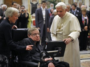 Pope Benedict XVI (R) greets British professor Stephen Hawking during a meeting of science academics at the Vatican October 31, 2008. REUTERS/Osservatore Romano (VATICAN)