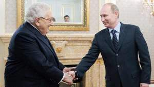 Henry-Kissinger-greets-Vladimir-Putin