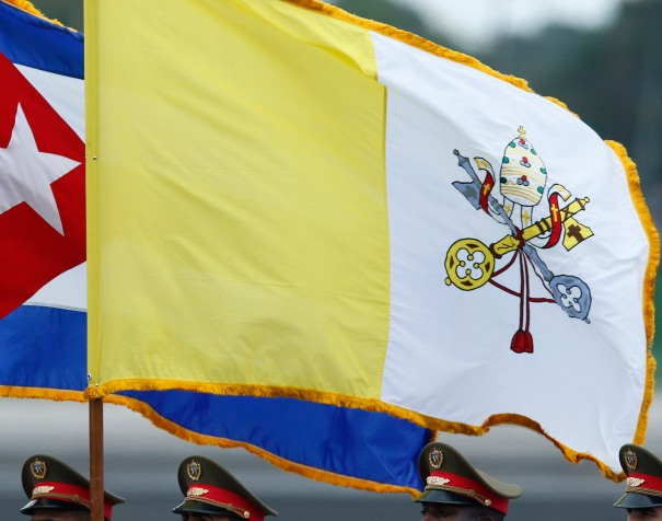 An honor guard carries the Cuban and Vatican flags during the arrival ceremony for Pope Francis at Jose Marti International Airport in Havana Sept. 19. (CNS photo/Paul Haring) See POPE-CUBA-ARRIVE Sept. 19, 2015.